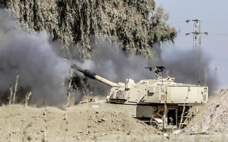 Rounds from an M109A6 Paladin are fired from a tactical assembly area to support an Iraqi security forces' offensive in West Mosul, Iraq, on Feb. 19, 2017. Iraqi forces on Thursday, May 4, began a new push into western Mosul, attempting to bring fresh momentum to the fight to retake Iraq's second-largest city from the Islamic State group.