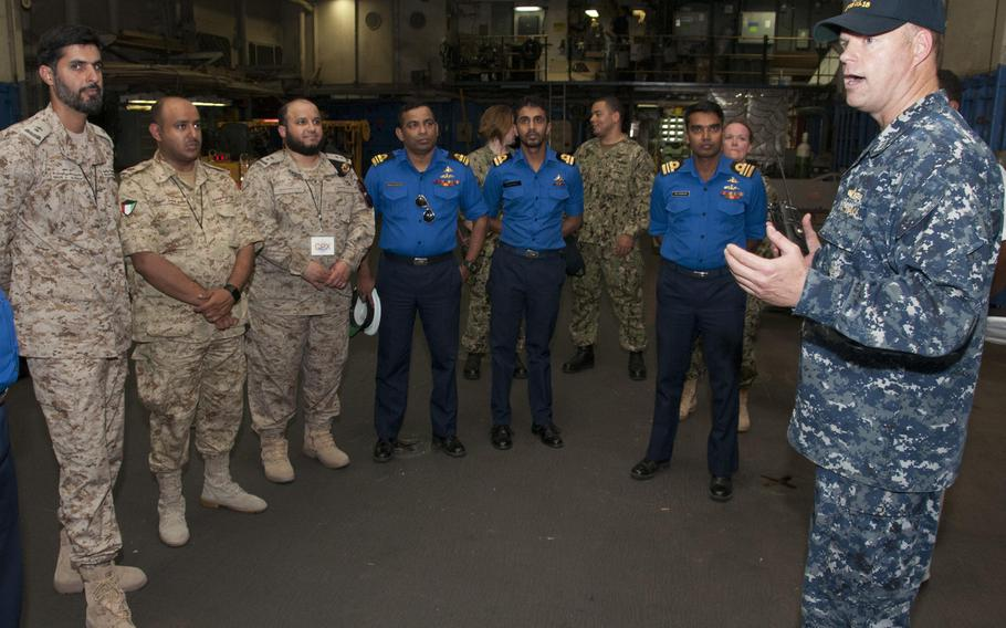 Lt. Mick Kalman discusses the capabilities of Afloat Forward Staging Base (Interim) USS Ponce with participants of the International Maritime Exercise (IMX) 2017.
