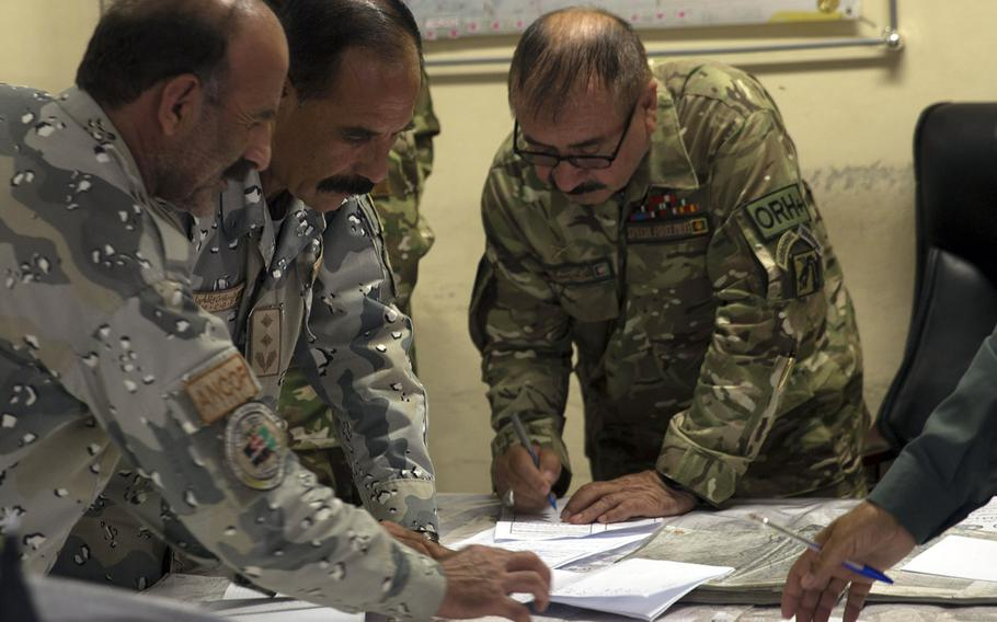 Afghan National Defense and Security Forces complete operational planning for Operation Maiwand Four at Bost Airfield, Afghanistan, July 13, 2017. Operation Maiwand four consists of ANDSF working together to clear the Nawa District of any enemy presence and to expand the security belt around Lashkar Gah.