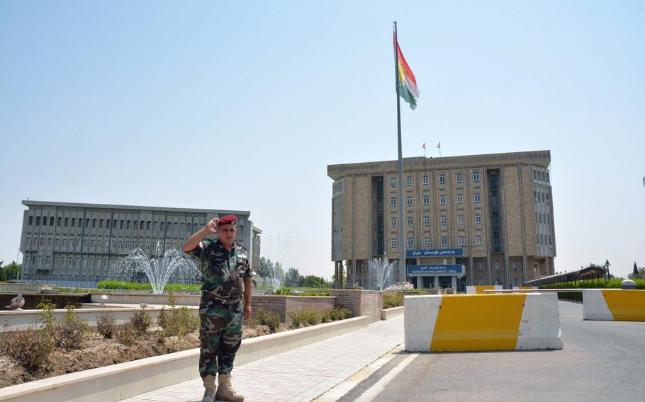 A large Kurdish flag flies in front of the Kurdistan parliament on July 23, 2017.