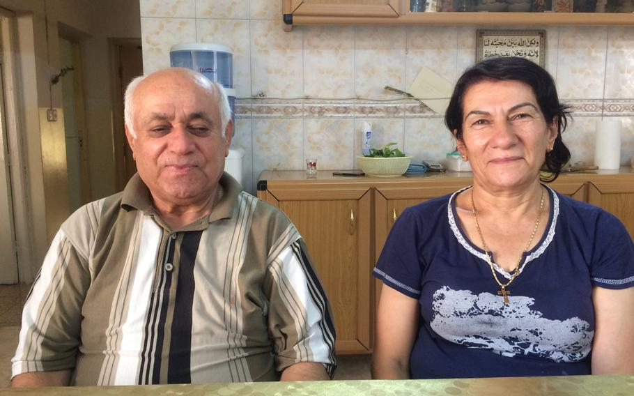 Younan Kosa, 72, and his wife, Amera, 63, a Christian couple living in Irbil's Ankawa neighborhood, are split over whether Kurdistan should seek independence from Iraq.