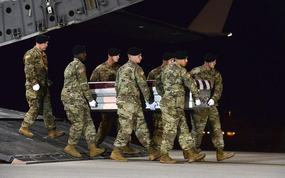 A U.S. military carry team transfers the remains of Army Staff Sgt. Dustin Wright late Thursday, Oct. 5, 2017, upon arrival at Dover Air Force Base, Del.  Wright was one of four U.S. troops killed in an ambush by dozens of Islamic militants. Wright along with Staff Sgts. Jeremiah W. Johnson, and Bryan C. Black were identified Friday, Oct. 6, as three of the four killed. The military on Saturday, Oct. 7, identified Sgt. La David Johnson as the fourth soldier killed.