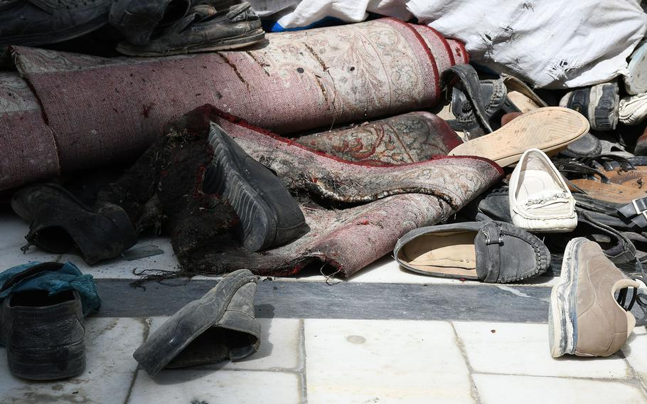 Discarded shoes outside the Imam Zaman mosque in Kabul, Afghanistan, on Saturday, Oct. 21, 2017.