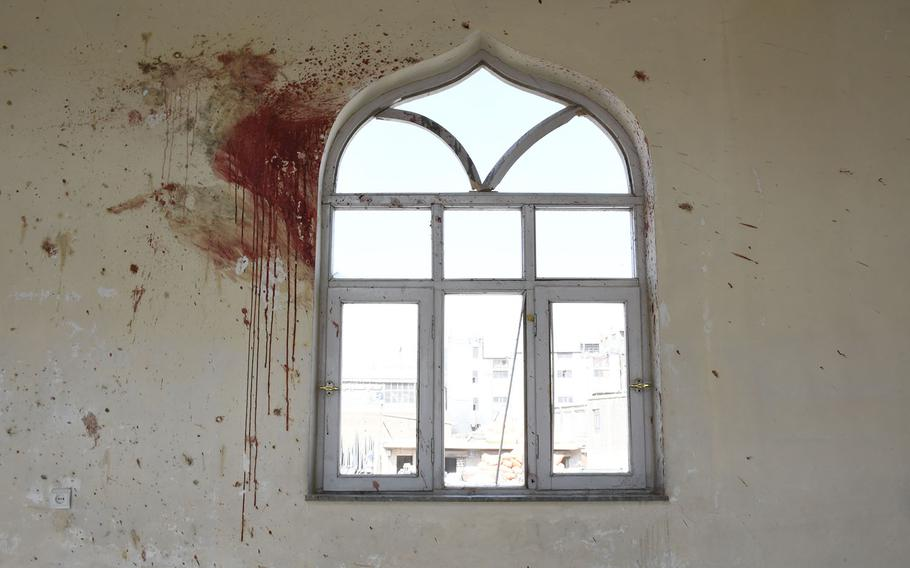 Blood stains the walls of the Imam Zaman mosque in Kabul, Afghanistan, on Saturday, Oct. 21, 2017, a day after an Islamic State suicide bomber targeted Shiite worshipers.