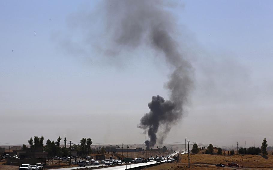Smoke rises as Iraqi security forces launch explosives as Kurdish security forces withdraw from a checkpoint in Altun Kupri, on the outskirts of Irbil, Iraq, Friday Oct. 20, 2017.