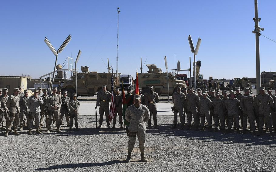 Marines from Task Force Southwest wait at parade rest for the start of a transfer of authority ceremony at Camp Shorab in Helmand province, Afghanistan, on Monday, Jan. 15, 2018. About 300 Marines from the task force's first rotation, represented by the platoon on the left, were relieved by a similarly-sized unit represented  by the platoon on the right.