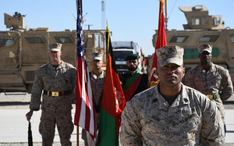 Gunnery Sgt. Alberto Andino stands at the front of a formation of Marines and a joint U.S.-Afghan color guard during a transfer of authority ceremony for Task Force Southwest at Camp Shorab in Helmand province, Afghanistan, on Monday, Jan. 15, 2018.