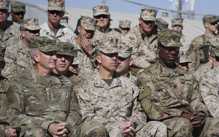 Pictured here from left to right during a transfer of authority ceremony at Camp Shorab in Helmand province, Afghanistan, on Monday, Jan. 15, 2018, is Gen. John W. Nicholson, commander of U.S. Forces - Afghanistan, Brig. Gen. Benjamin T. Watson, Task Force Southwest rotation two commander, and Command Sgt. Maj. David M. Clark, U.S. Forces - Afghanistan senior enlisted advisor.