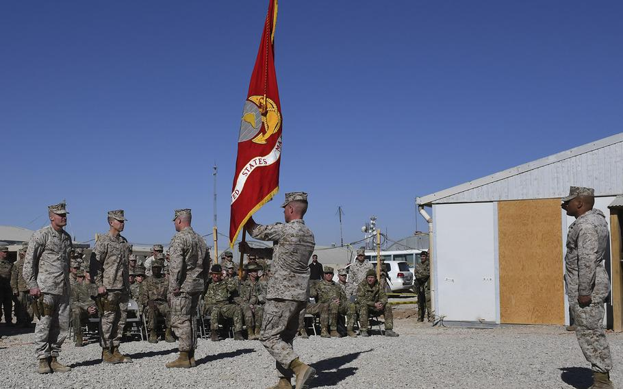 During a transfer of authority ceremony at Camp Shorab in Helmand province, Afghanistan, on Monday, Jan. 15, 2018, Brig. Gen. Roger B. Turner Jr., outgoing commander of Task Force Southwest, awaits the guidon he will pass to his successor, Brig. Gen. Benjamin T. Watson.