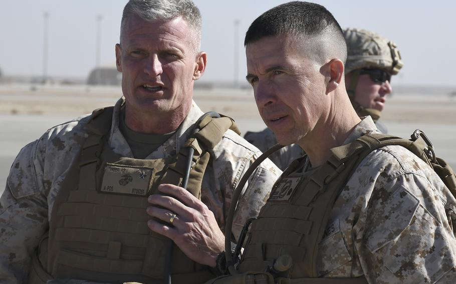 Brig. Gen. Roger B. Turner Jr., left, speaks with Brig. Gen. Benjamin T. Watson on Monday, Jan. 15, 2018, at Camp Shorab in Helmand province, Afghanistan, shortly after Watson assumed command of Task Force Southwest from Turner in a transfer of authority ceremony.
