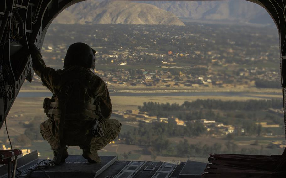 A crew chief surveys the area over Jalalabad, Afghanistan December 5, 2017. The helicopter and its crew are part of Task Force Lighthorse, 3rd Squadron, 17th Cavalry Regiment, out of Savannah, Georgia supporting Operations Freedom's Sentinel and Resolute Support in Afghanistan.