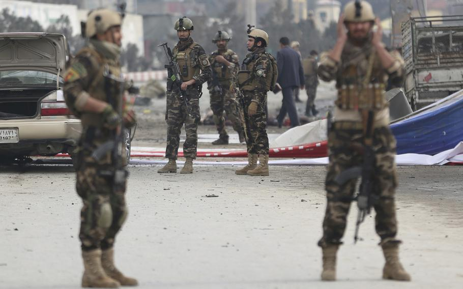 Security forces inspect the site of a suicide attack in Kabul, Afghanistan, Friday, March 2, 2018. A large explosion in the Afghan capital Friday killed at least one and wounded two dozen others, officials said.