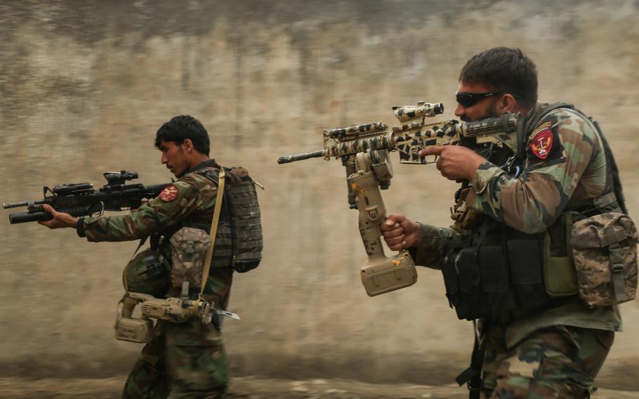 Afghan commandos assigned to 1st Special Operations Kandak clear a training compound during  breaching training in Laghman province, Afghanistan, Feb. 13, 2018.