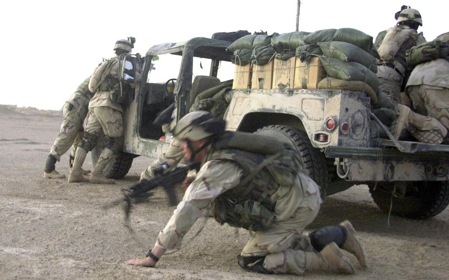 Soldiers near Fallujah scramble into position as rounds come in just minutes after Company B troops left Forward Operating Base Mercury in September 2003. The shooters melted into the night before soldiers could return fire or capture them.