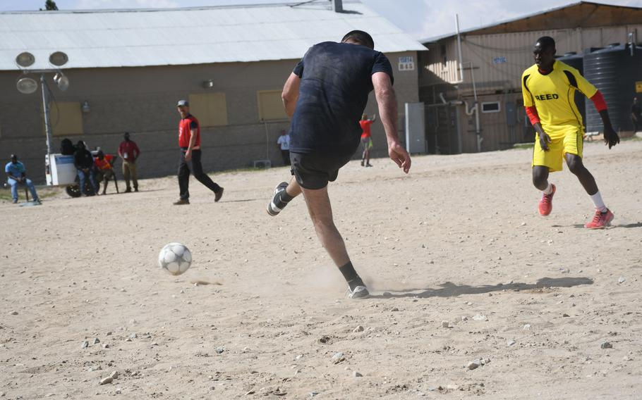 A Georgian player kicks the ball during a soccer match at Bagram Air Filed on Friday, March 23, 2018, during the Bagram World Cup tournament.