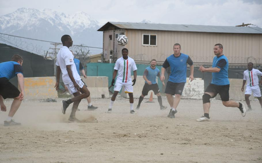 Zimbabwe players in white compete against Czech players in blue during a Bagram World Cup soccer match on Friday, March 23, 2018.