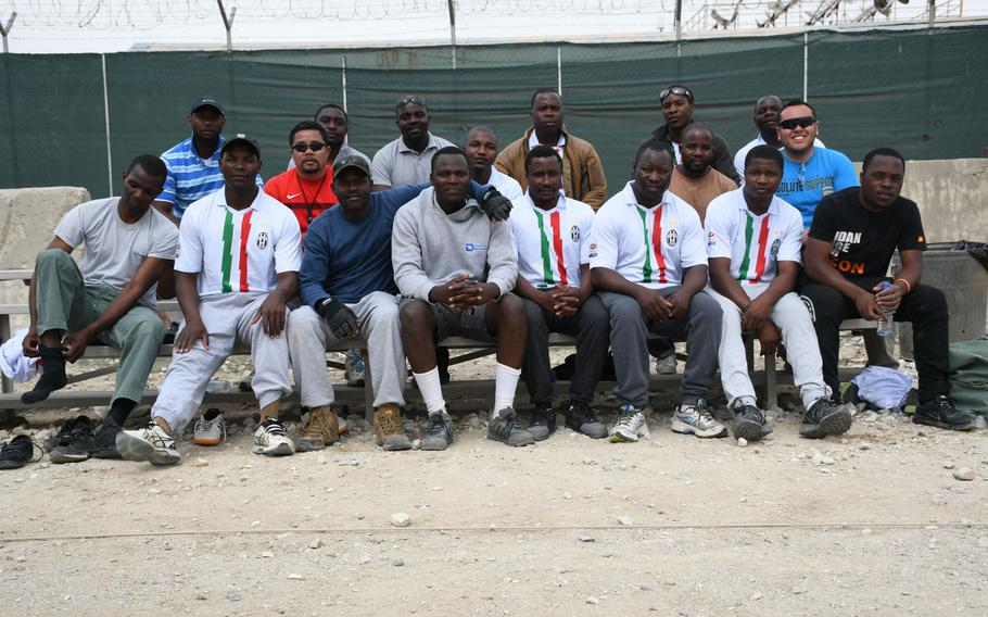 Don Baumgartner, right in blue, sits with players from Zimbabwe competing in the Bagram World Cup on Friday, March 23, 2018, in Afghanistan.