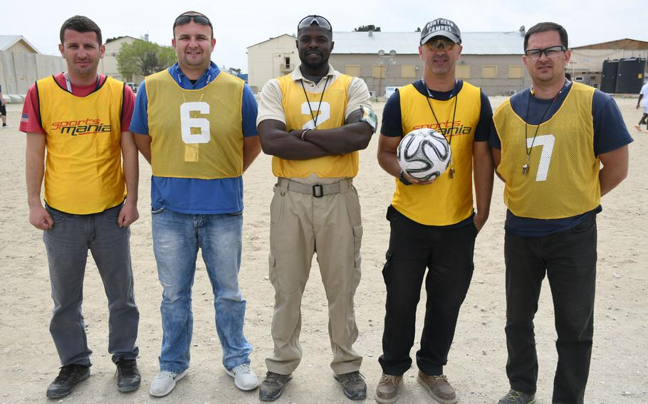 Referees Shpend Haxhimurati of Kosovo, from left, Aner Becirovic of Bosnia, Emmanuel Bulimo of Kenya, Elmir Valjevac of Bosnia and Agron Krasniqi of Kosovo pose on the sidelines of a Bagram World Cup match on Friday, March 23, 2018.