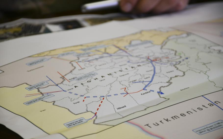 A map inset, pictured here on Tuesday, Dec. 19, 2017, shows the scope of U.S.-funded power projects planned to form a circuit through Afghanistan and power the country's rural areas.