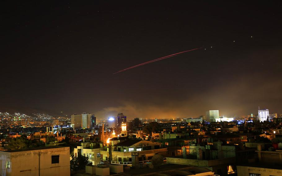 Explosions light up the skies with anti-aircraft fire over Damascus, the Syrian capital, as the U.S. launches an attack early Saturday, April 14, 2018. U.S. President Donald Trump announced airstrikes in retaliation for the country's alleged use of chemical weapons.