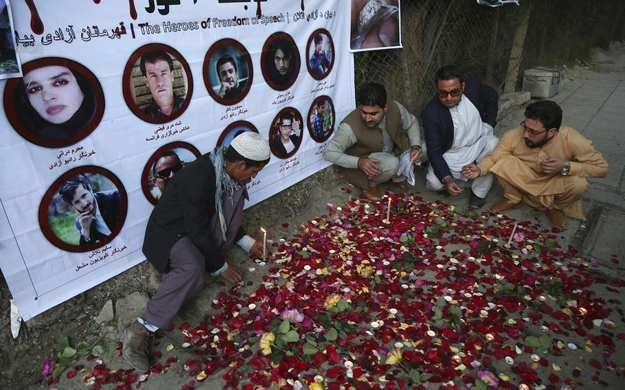 Afghan residents light candles Thursday, May 3, 2018, to pay tribute to Afghan journalists killed in Monday's suicide attack in Kabul, Afghanistan. Two Islamic State suicide bombers struck in Afghanistan's capital on Monday, April 30, 2018, killing 25 people, including nine journalists who had rushed to the scene of the first attack, in the deadliest assault on reporters since the fall of the Taliban in 2001.