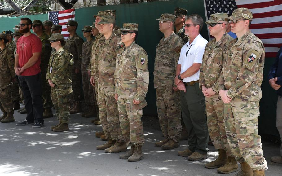 Troops and civilian contractors from U.S. and coalition countries attend an Independence Day ceremony at NATO's Resolute Support headquarters on Wednesday, July 4, 2018.
