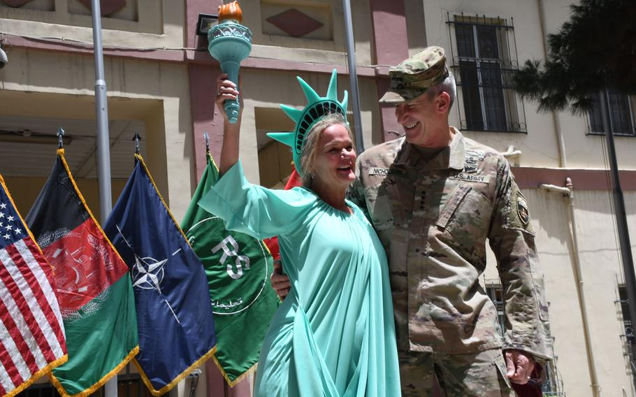 Stephenie Jonas-Sullivan, left, a U.S. citizen who advises the Afghan Interior Ministry on gender issues, celebrates Independence Day with Gen. John Nicholson, the U.S.'s top commander in Afghanistan, at NATO's Resolute Support headquarters on Wednesday, July 4, 2018.