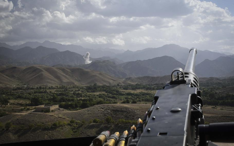 A M-240B machine gunner's view of the aftermath of a bombing run by an U.S. F-16 fighter-bomber against positions held by Islamic State militants in Deh Bala district in Nangarhar province Saturday, July 7, 2018.