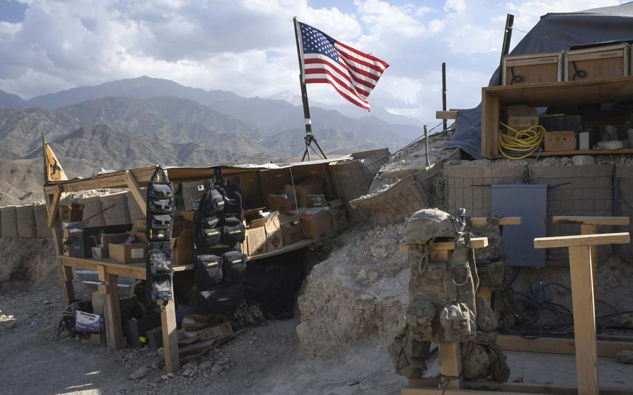 A U.S. flag flies over Observation Post Krakken, a checkpoint overlooking a key valley in Deh Bala district in Nangarhar province, Afghanistan, Saturday,  July 7, 2018.