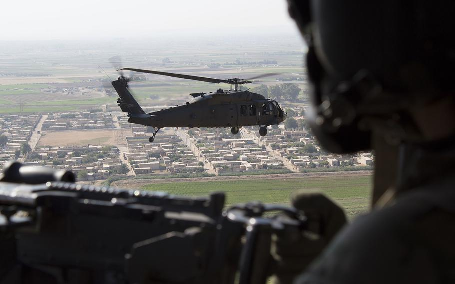 A U.S Army UH-60 Black Hawk door gunner watches as another Black Hawk flies over Syria on July 10, 2018.  French Brig. Gen. Frederic Parisot, the director of civil-military operations of the U.S.-led Operation Inherent Resolve coalition, said at least two to three months of fighting remains to end the ISIS caliphate.