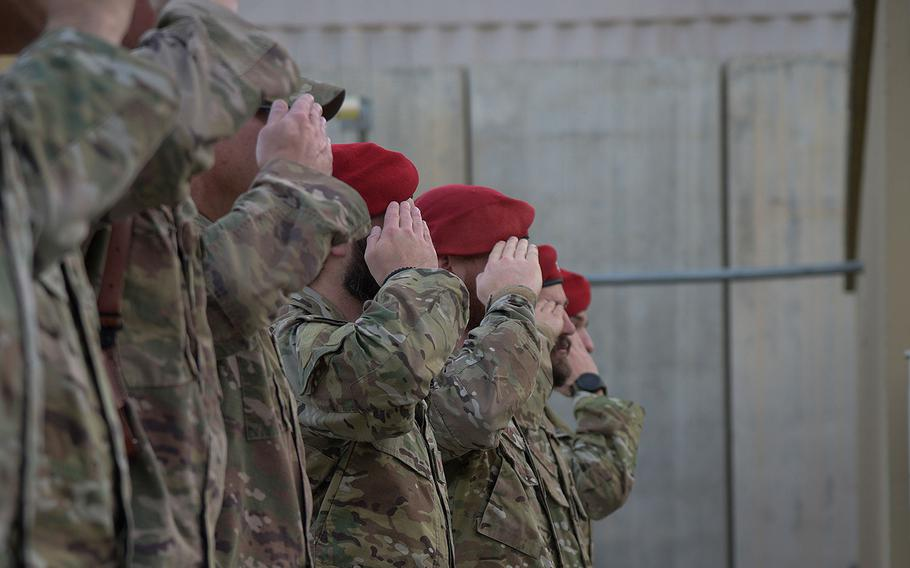 Airmen salute during the Medal of Honor ceremony for U.S. Air Force Master Sgt. John Chapman on Bagram Airfield, Afghanistan, August 28, 2018. Chapman was posthumously awarded the MOH for his actions during the Battle of Takur Ghar, also known as Roberts Ridge, in Afghanistan in March 2002.