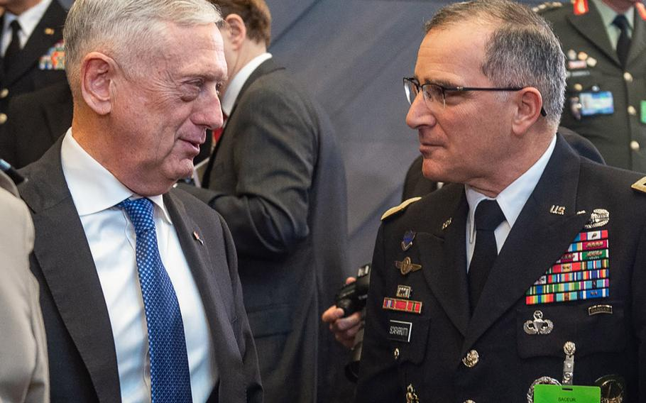 Defense Secretary Jim Mattis talks with Gen. Curtis Scaparrotti, Supreme Allied Commander Europe, during the NATO defense ministers meeting in Brussels, Oct. 4, 2018.