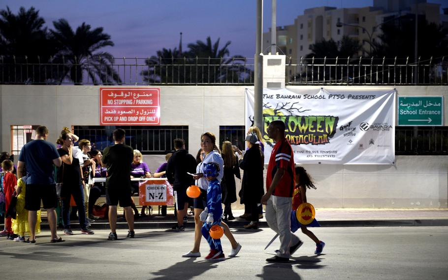 Volunteers check in families for the Bahrain School's Spooktakular event on Thursday, Oct. 25, 2018. The two-day event saw as many as 1,000 participants led by 150 volunteers, including 25 sailors from nearby Naval Support Activity Bahrain.