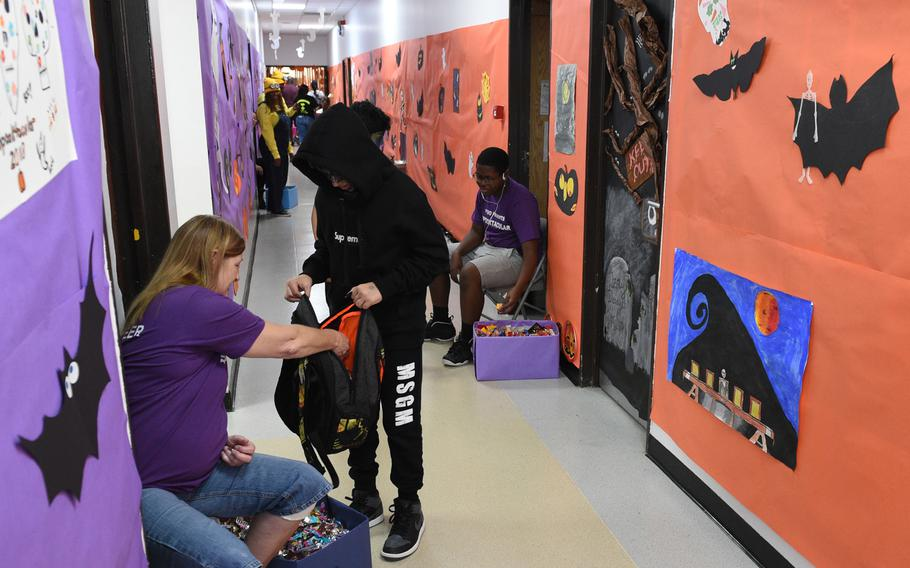 Children in costumes trick-or-treat for candy in the hall at the Bahrain School's Spooktakular event on Thursday, Oct. 25, 2018.