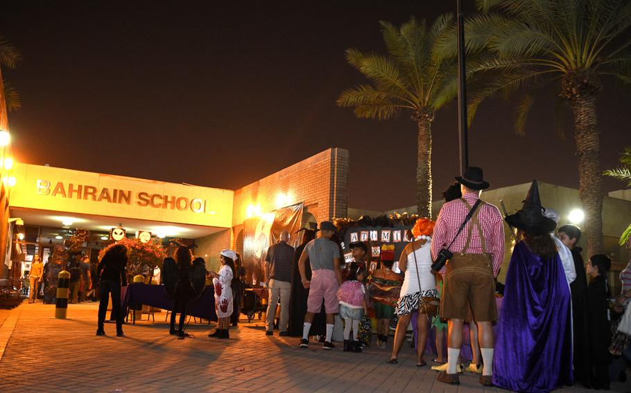 Families check in at the Bahrain School's Spooktakular event on Thursday, Oct. 25, 2018.