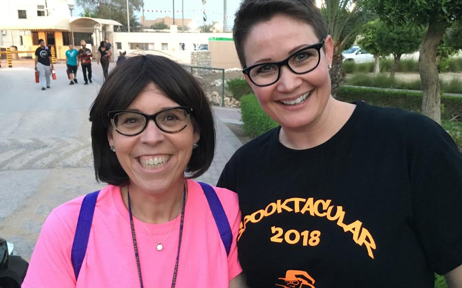 Penelope Miller-Smith, elementary school principal, and Julie Frerot, special education teacher and event organizer, pose for a photo at the Bahrain School's Spooktakular event Thursday, Oct. 25, 2018.