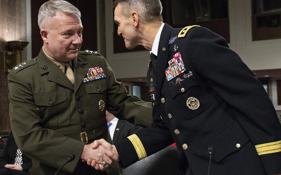 Lt. Gen. Kenneth F. McKenzie, Jr., left, nominee to serve as commander of U.S. Central Command, shakes hands with Lt. Gen. Richard D. Clarke, nominee to serve as commander of U.S. Special Operations Command, before their Senate Armed Services Committee confirmation hearing on Capitol Hill, Dec. 4, 2018.