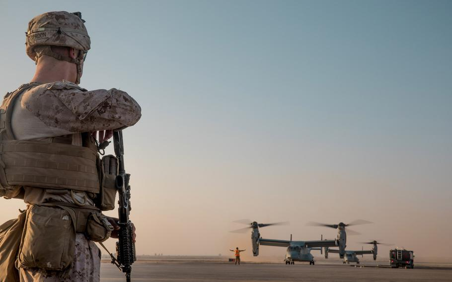 A U.S. Marine with 3rd Battalion, 7th Marine Regiment, prepares to board an MV-22 Osprey on his way to a site near At-Tanf Garrison, Syria, Sept. 7, 2018. The White House announced Wednesday, Dec. 19, 2018, that U.S. forces will start withdrawing from Syria after defeating the Islamic State in the country.