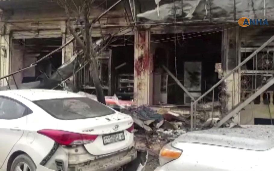 This frame grab from video shows a damaged restaurant where an explosion occurred, in Manbij, Syria, Wednesday, Jan. 16, 2019.