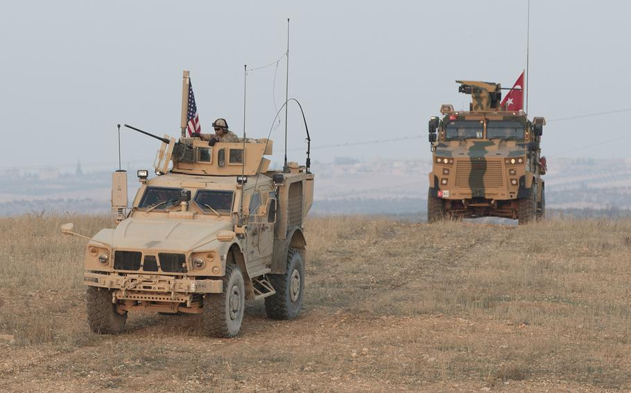 American and Turkish troops conduct a convoy during a joint combined patrol in Manbij, Syria, on Nov. 8, 2018.