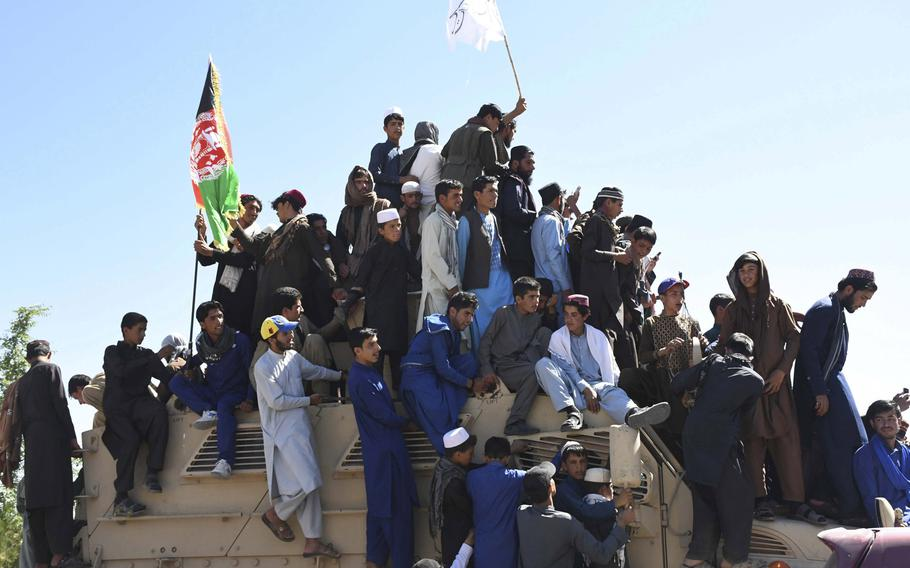 A crowd flying both Taliban and Afghan flags climbed aboard military vehicles for impromptu parades last June in Logar province during an unprecedented truce between the Taliban and the Afghan government. Talks between the Taliban and the U.S. may progress which could lead to compromises being made which could allow Taliban laws to be put into place.