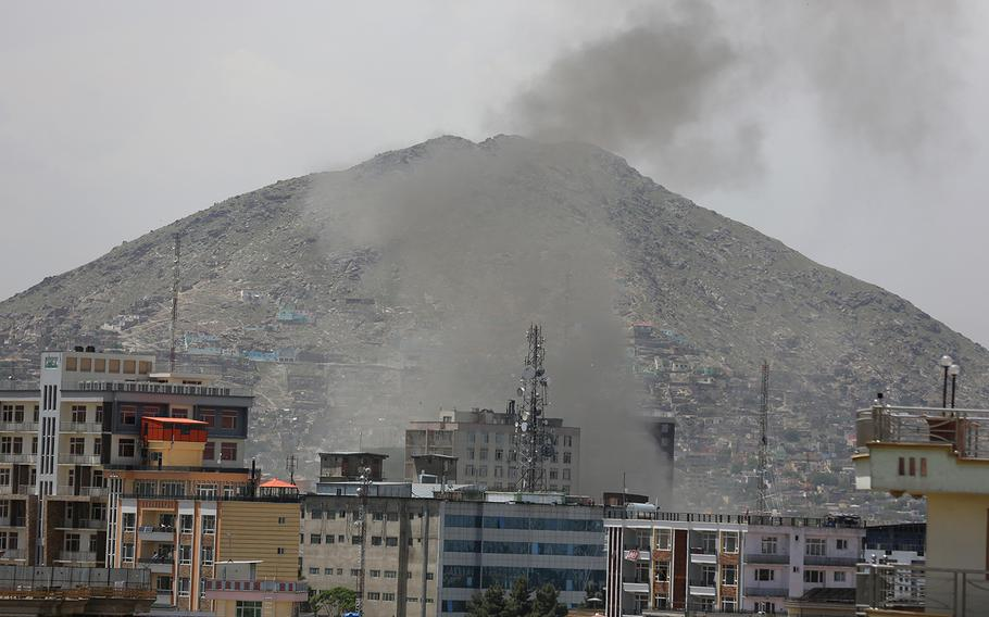 Smokes rises after a huge explosion near the offices of the attorney general in Kabul, Afghanistan, Wednesday, May 8, 2019.