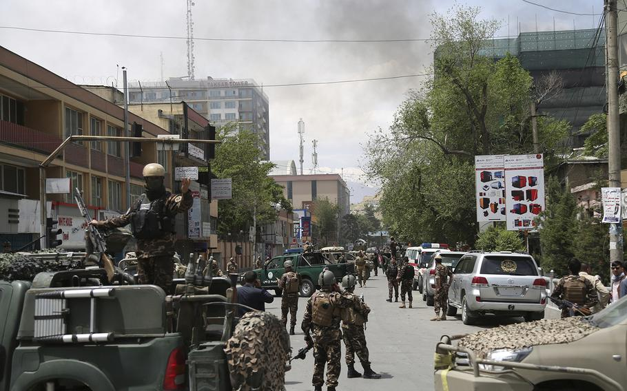 Afghan security personnel arrive near the site of a huge explosion in Kabul, Afghanistan, Wednesday, May 8, 2019.