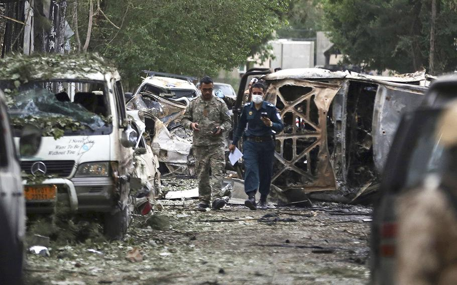 Afghan security forces guard the site of an explosion in Kabul, Afghanistan, Wednesday, May 8, 2019.