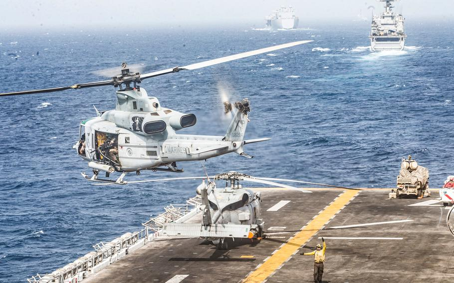 A UH-1Y Venom helicopter takes off from the flight deck of the amphibious assault ship USS Boxer (LHD 4) on July 18, 2019, while transiting through the Strait of Hormuz