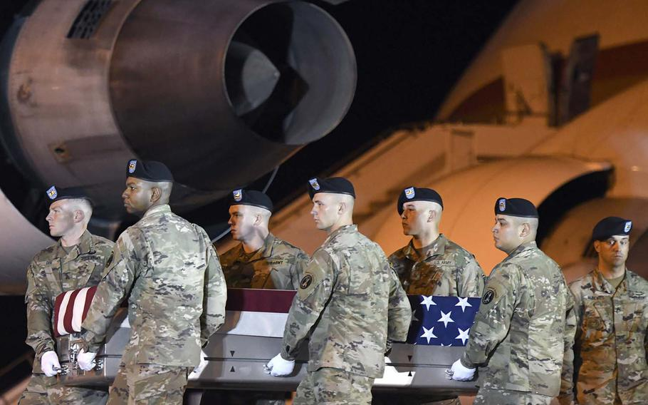An Army carry team moves a transfer case containing the remains of Spc. Michael I. Nance at Dover Air Force Base, Del., on Wednesday, July 31, 2019. Nance, 24, of Chicago, died July 29, 2019, in Tarin Kowt, Uruzgan province, Afghanistan, from wounds sustained in combat.