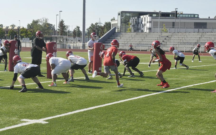 The Kaiserslautern Raiders prepare for an offensive snap during a preseason Kaiserslautern Raiders football practice Friday, Aug. 23, 2019, at Kaiserslautern, Germany.
