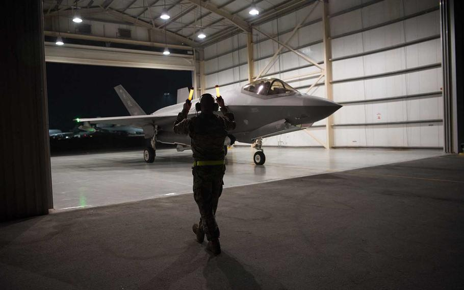 A U.S. Air Force F-35A Lightning II aircraft, assigned to the 4th Expeditionary Fighter Squadron, is guided from the hangar Sept. 10, 2019, at Al Dhafra Air Base, United Arab Emirates. F-15s and F-35s dropped 80,000 pounds of bombs on an island in the Tigris River in Iraq.