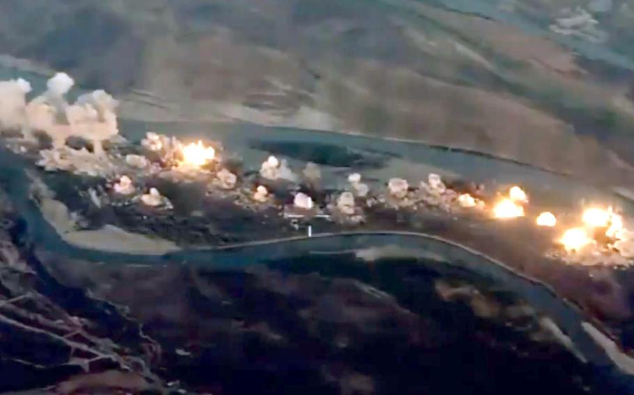 A image from a video released by Combined Joint Task Force shows 80,000 pounds of bombs being dropped on an island believed to be used by ISIS, Sept. 10, 2019.