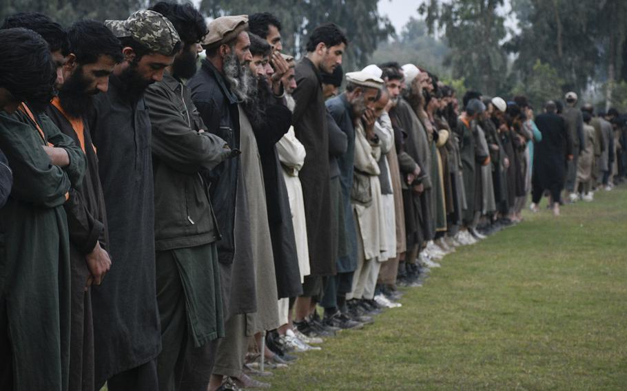 Islamic State fighters line up Nov. 19, 2019, in Jalalabad, Afghanistan, after surrendering to the Afghan government. An estimated 2,000 ISIS fighters and their family members are expected to surrender after government offensives, supported by U.S. and coalition forces, cut off their supply lines.